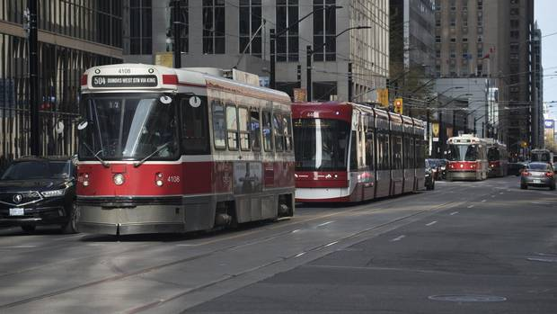 A line of TTC streetcars westbound on King St. West, are pictured approaching University Ave. on May 11 , 2017.