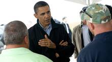 US President Barack Obama speaks with local fishermen about how they are affected by the BP oil spill after meeting with officials at Coast Guard Station Venice in Venice, Louisiana, May 2, 2010. (SAUL LOEB/AFP/Getty Images)