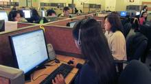 Telus call centre in a Manila mall, February 2012. (Andy Hoffman/ANDY HOFFMAN/THE GLOBE AND MAIL)