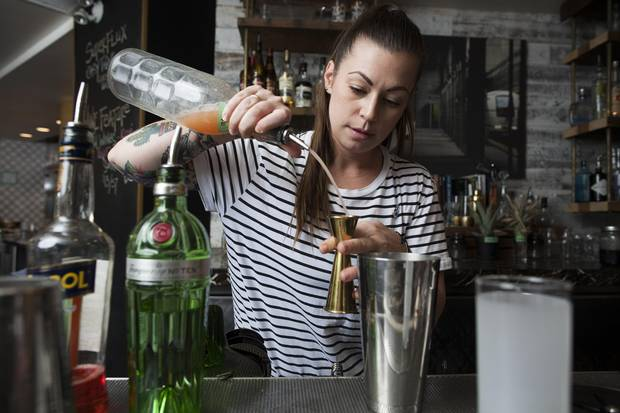 Canadian bartender Kaitlyn Stewart, who won the Diageo World Class cocktail competition in Mexico City last month, prepares one of her winning drinks, the Tom Cat Collins.