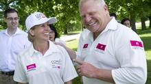 Mayoral candidate Karen Stintz and Doug Ford join CIMA cricket action at the CIMA Mayor's Trophy Cricket Tournament at Sunnybrook Park in Toronto, Ontario, Saturday, Jun 21, 2014. (Kevin Van Paassen For The Globe and Mail)