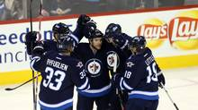 Winnipeg Jets defenceman Grant Clitsome (24) celebrates with teammates after scoring against the San Jose Sharks during the second period at MTS Centre. (Bruce Fedyck/USA Today Sports)