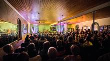 Audience members are invited to drink and dance with writers and musicians at Woody Point. (Tom Cochrane)