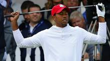U.S. golfer Tiger Woods reacts to his tee shot on the 13th hole during the morning foursomes round at the 39th Ryder Cup golf matches at the Medinah Country Club in Medinah, Illinois September 28, 2012. (MIKE BLAKE/REUTERS)