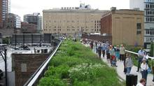 New York's High Line, a garden and walking path built on a overhead rail platform.