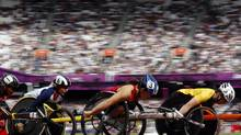 (L-R) Switzerland's Alexandra Helbling, Britain's Shelly Woods, Shirley Reilly of the U.S. and Australia's Christie Dawes compete in the Women's 1500 - T54 heats in the Olympics Stadium during the London 2012 Paralympic games September 6, 2012. (LUKE MACGREGOR/Reuters)