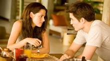 Kristen Stewart and Robert Pattinson lock eyes in a scene from The Twilight Saga: Breaking Dawn, Part 1