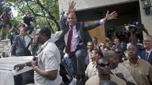 Haiti's presidential candidate Michel 'Sweet Micky' Martelly greets supporters after giving a press conference in Port-au-Prince, April 5, 2011. (Dieu Nalio Chery/AP/Dieu Nalio Chery/AP)