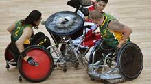 Trevor Hirschfield of Canada (C) collides with Ryley Batt (R) and Naz Erdem (L) of Australia during the Wheelchair Rugby final at the London 2012 Paralympic Games September 9, 2012. (TOBY MELVILLE/REUTERS)