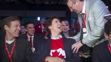 Federal Liberal leader Justin Trudeau, centre, chats with delegates during the party's biennial convention in Montreal, Sunday, Feb. 23. (Graham Hughes/THE CANADIAN PRESS)
