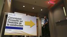 A sign points to the Charbonneau commission, a public inquiry into corruption within Quebec's construction industry, in Montreal September 17, 2012. (CHRISTINNE MUSCHI/Reuters)