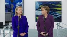 German Chancellor Angela Merkel and U.S. Secretary of State Hillary Clinton (L) address the media prior to a meeting at the Chancellery in Berlin April 14, 2011. (REUTERS/Saul Loeb/Pool)