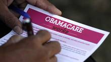 A man fills out an information card during an Affordable Care Act outreach event hosted by Planned Parenthood for the Latino community in Los Angeles, California September 28, 2013. As the government shutdown deadline looms, the U.S. Senate stands firm on rejecting measures that would delay Obamacare. (JONATHAN ALCORN/REUTERS)