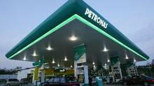 Malaysia's Petronas has agreed to sell a 25-per-cent stake in its Canadian shale gas assets to an Indian company and an Asian gas buyer. (Bazuki Muhammad/Reuters)
