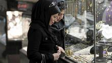 Women look at jewellery at a shop window in a bazaar in northern Tehran. For months, Iranians have endured economic hardship, political repression and international isolation as the authorities refuse to halt sensitive nuclear work as demanded by the UN Security Council. (Morteza Nikoubazl/Reuters/Morteza Nikoubazl/Reuters)