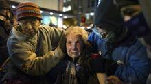Seattle activist Dorli Rainey, 84, reels after being doused with pepper spray at an Occupy Seattle protest in Westlake Park on Tuesday. (Joshua Trujillo/Associated Press/seattlepi.com)