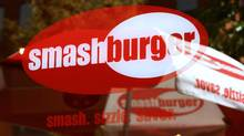 Smashburger signage is displayed in the window a restaurant in Denver. (Matthew Staver/MATTHEW STAVER/BLOOMBERG)