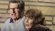 Joe Paterno and his wife Susan stand on their porch to thank well-wishers gathered outside in State College, Pa., Wednesday, Nov. 9, 2011. The Penn State board of trustees fired Paterno as football coach earlier Wednesday. The board also fired university president Graham Spanier. (AP Photo/Gene J. Puskar) (Gene J. Puskar/AP)