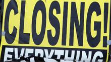 A store closing sign sits outside a Blockbuster movie rental store in Superior, Colorado in this November 19, 2009 file photo. (RICK WILKING)