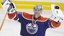 Edmonton Oilers goalie Nikolai Khabibulin (35), from Russia, celebrates his team's win in the overtime shootout of an NHL hockey game in Edmonton, Alberta on Tuesday, October 6, 2009. The good news for the Edmonton Oilers is Khabibulin already appears to be in mid-season form. The bad news, with all the rubber the steadfast Russian goaltender has faced, is he's had to be. THE CANADIAN PRESS/Jimmy Jeong (Jimmy Jeong)