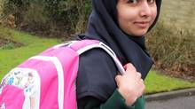 Image made available by her press office of Malala Yousafzai, the Pakistani schoolgirl shot in the head by the Taliban, as she attends her first day of school on March 19, 2013, just weeks after being released from hospital. (Malala Press Office/AP)