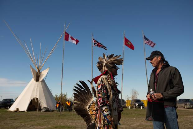 People gather at a traditional pow wow to honour Chief Bobtail, who signed the adhesion to Treaty 6 in 1877, in Maskwacis, Alberta on Sunday, September 25, 2016. The province is offering the band a junior water license, that wouldn't protect the community's access to the aquifer in a drought.
