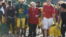 Toronto Mayor Rob Ford, in red, walks off the field after coaching football at Don Bosco Catholic Secondary School in Toronto Sept. 12, 2012. (Matthew Sherwood For The Globe and Mail)