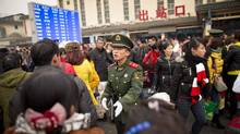 Xi'an's train station is a hub of activity in the annual migration of millions before the Chinese New Year holiday. (John Lehmann/The Globe and Mail)
