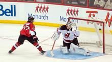 Ottawa Senators defenceman Erik Karlsson scores the game-winning shootout goal against New Jersey Devils goalie Cory Schneider in Ottawa on Thursday, April 10, 2014. (Marc DesRosiers/USA Today Sports)