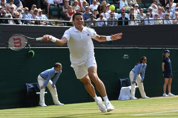 Canada's Milos Raonic returns to US player Sam Querrey during their men's singles quarter-final match on the tenth day of the 2016 Wimbledon Championships at The All England Lawn Tennis Club in Wimbledon, southwest London, on July 6, 2016.