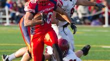 Simon Fraser University's Bo Palmer rushes against Central Washington during Great Northwest Athletic Conference football action Nov. 5, 2011. (Ron Hole/THE CANADIAN PRESS)