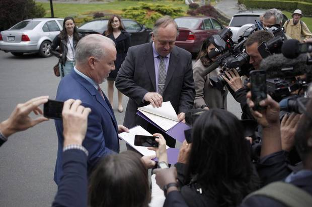 B.C. NDP Leader John Horgan and B.C. Green Party leader Andrew Weaver speak to media after arriving at Government House in Victoria to drop of a signed agreement between their parties on May 31, 2017.