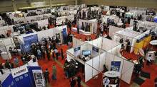 Hundreds of people looking work attend the National Job Fair & Training Expo at the Metro Toronto Convention Centre in 2012. (J.P. Moczulski For The Globe and Mail)