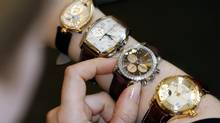 A saleswoman displays brands belonging to the Swiss Swatch Group in this file photo. (SIGGI BUCHER/REUTERS)