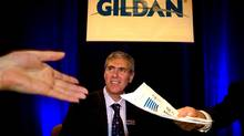 January 31, 2008-- Some financial notes are passed in front of Glenn Chamandy President and CEO prior to Gildan's annual general meeting in Montreal on January 31, 2008. (Christinne Muschi/Christinne Muschi for The Globe and Mail)