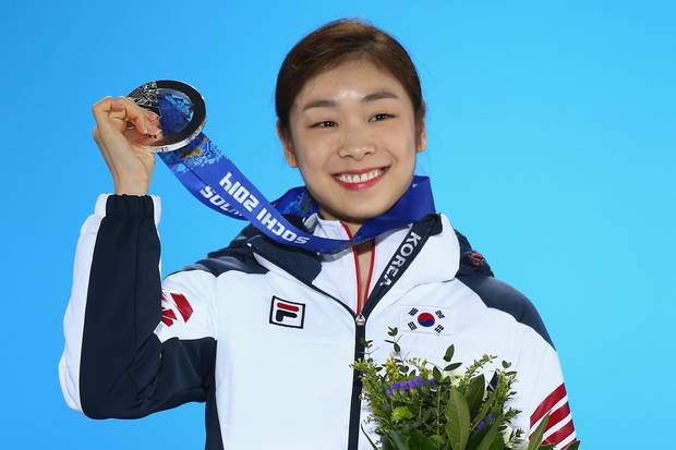 Yuna Kim of South Korea celebrates after winning silver at the Sochi Olympics in 2014.