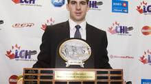 John Tavares, with the London Knights of the OHL, poses with his Top Draft Prospect trophy at the Canadian Hockey League awards in Rimouski. (Ryan Remiorz)