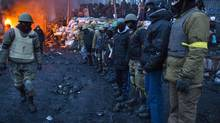 Protesters prepare for another night of watching over their makeshift barricade in Kiev, Ukraine, Jan. 28, 2014. (John Lehmann/The Globe and Mail)