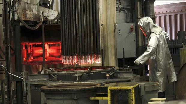 An employee prepares metal rods at the Boart Longyear plant in Mississauga that will be used in future drilling operations. The Utah-based company produces steel drill rods, drill bits and drills used in mining operations across the world. (Deborah Baic/The Globe and Mail)