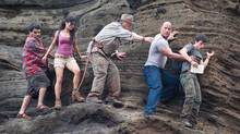 "Luis Guzman, Vanessa Hudgens, Michael Caine, Dwayne Johnson and Josh Hutcherson in a scene from ""Journey 2: The Mysterious Island."" (Ron Phillips/AP Photo/Warner Bros.)"
