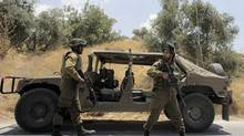 Israeli soldiers patrol near the West Bank city of Hebron on June 13, 2014. (AMMAR AWAD/REUTERS)