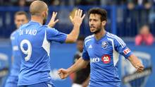 Montreal Impact forward Marco Di Vaio (9) celebrates with teammate Felipe Martins (7) after scoring a goal against the Philadelphia Union during the second half at Stade Saputo. (Eric Bolte/USA Today Sports)