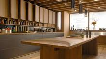 Hand made cabinetry and a milled harvest table are combined in a contemporary working kitchen designed by Toronto-based Williamson Chong Architects. (Bob Gundu)