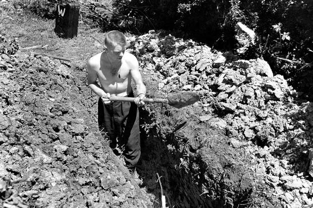 Summer, 1944: Jack Ford digs a trench the morning after an air raid on his first night in Normandy.