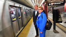 Ontario Premier Kathleen Wynne, right, and Glen Murray, Minister of Infrastructure, wait to board the subway while en route to Wynne's speech at the Toronto Region Board of Trade in Toronto Monday, April 14, 2014. (Darren Calabrese/THE CANADIAN PRESS)