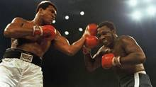 Muhammad Ali, left, and Joe Frazier fight in a 12-round non-title fight at Madison Square Garden in New York in 1974. (AP)