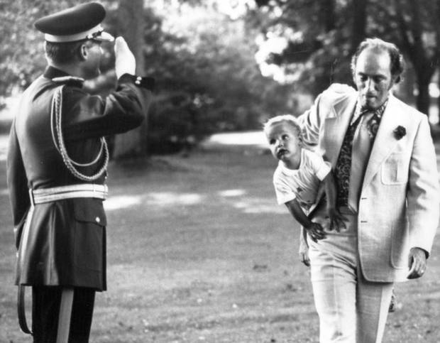 Prime minister Pierre Trudeau cradles a young Justin under his arm in Ottawa on Aug. 10, 1973.