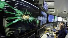A graphic showing a collision at full power is pictured at the Compact Muon Solenoid experience control room of the Large Hadron Collider at the European Organisation for Nuclear Research in Meyrin, near Geneva in this file picture taken March 30, 2010. (DENIS BALIBOUSE/REUTERS)