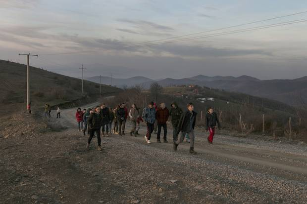 Young people from remote Albanian and Serbian villages walk through the hills of Germia just outside of Pristina during a camp intended to encourage reconciliation between Kosovo's two main ethnic groups. The camps are run by Nazmi Hasanramaj, who was one of the first three Kosovars to climb Mount Everest in 2017.