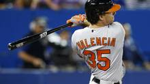 Baltimore Orioles Danny Valencia hits a two RBI double against theToronto Blue Jays during the third inning of their American League baseball game in Toronto, September 15, 2013. (MARK BLINCH/REUTERS)